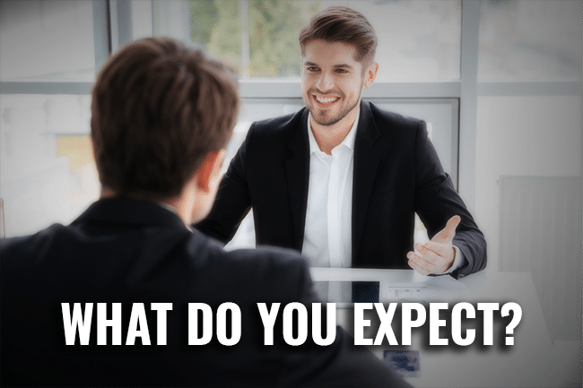 Hidden or clear Expectations_ man smiling_what do you expect from your team